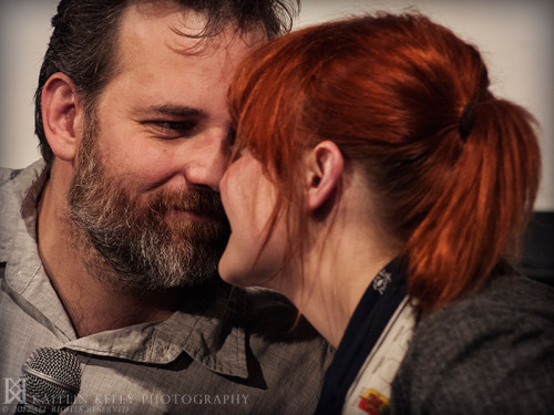 "havingchanged:  kaitlin-kelly:  Erin McGathy and Dan Harmon at the ""This Feels Terrible"" live show at UCB Los Angeles. —© 2012 Kaitlin Kelly  They are so perfect.  Well, at least he's happy."