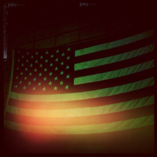 Through dark nights + bright lights #usa #flag #america  (at San Juan)