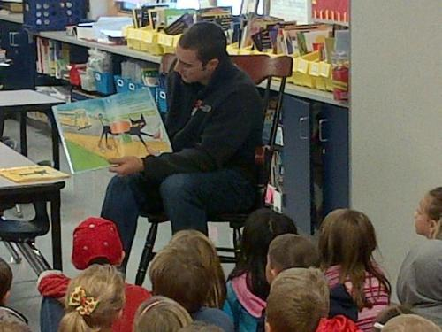 "Aaron reading ""Pete the Cat"" to 1st graders at Heritage Elementary yesterday."