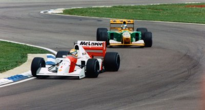 the racing line …Ayrton Senna (Marlboro McLaren-Honda MP4/7) leads Michael Schumacher (Camel Benetton-Ford B192) at Silverstone, 1992 British Grand Prix