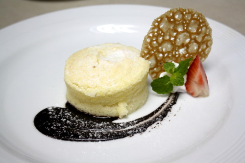Yogurt Semolina Pudding with chocolate sauce on the sides, garnish with Brandy Snap and mint leaf
