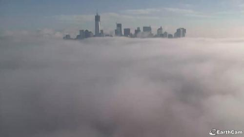 New York fog low over the harbor, making Lower Manhattan looking like it's heaven. © EarthCam