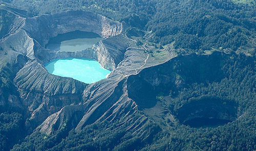 Kelimutu - Indonesia's Tri-Colored Lakes Located on the same volcanic peak yet each of the three crater lakes atop Kelimutu in Indonesia is a markedly different color. It is the only place on earth where this amazing color variation takes place.For centuries local people believed that the lakes are the spiritual resting place of their ancestors. It is said the lakes change color according to the mood of the spirit - and if that is the case then the souls' moods are constantly restless. (via The Presurfer: Kelimutu - Indonesia's Tri-Colored Lakes)