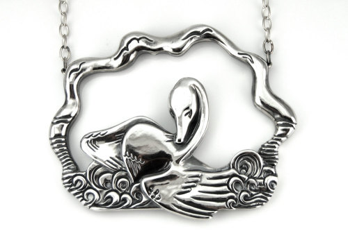This hand-carved pendant was inspired when I was fortunate to witness a swan bathing it's lovely feathers. This plate is scenic and absolutely gorgeous. http://www.etsy.com/listing/112395939/large-swan-necklace-sterling-silver