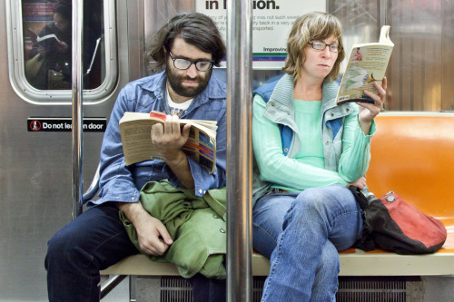 "on the left he's reading ""Cloud Atlas,"" by David Mitchell. on the right she's reading ""The Namesake,"" by Jhumpa Lahiri. Cloud Atlas: Borrow I Read The Namesake: Borrow I Read"