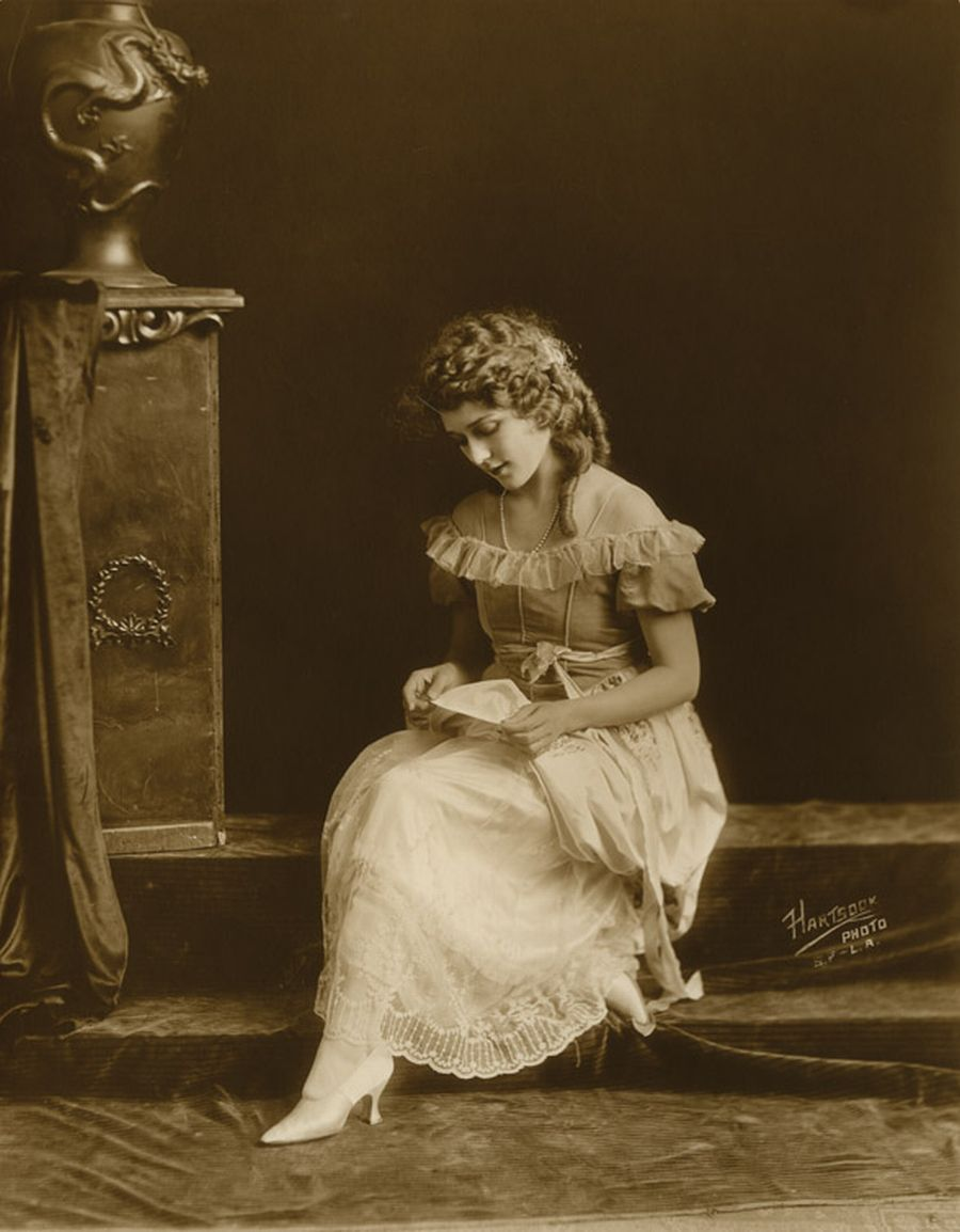 "Mark Pickford reading a card or letter. Pickford's private collection. Hartsook Photo. Fred Hartsook gained prominence through his celebrity clients, which included silent era Hollywood actors such as Mary Pickford and Lillian Gish, other celebrities such as pilot Charles Lindbergh, entrepreneur Henry Ford, and opera singer Geraldine Farrar, and politicians. The 40-minute sitting with President Woodrow Wilson in September 1919 was ""the first formal sitting since Mr. Wilson became president."""