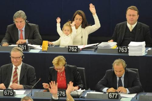 chiaraatik:  Licia Ronzulli is an Italian member of Parliament, who has sat on the European Parliament since 2008. In 2010, she took her infant daughter with her to a session as a symbolic gesture to reclaim more rights for women in reconciling work and family life. She has continued to take her daughter, Vittoria, to sessions. When Licia votes, Vittoria votes, too. Role model.