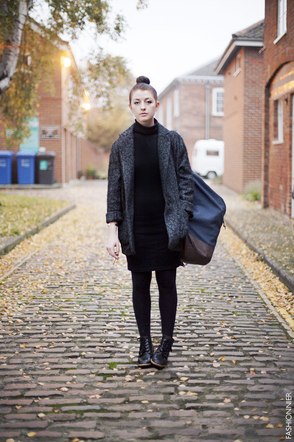 Helen… a black turtle neck dress and a large herringbone coat.  Norwich, UK