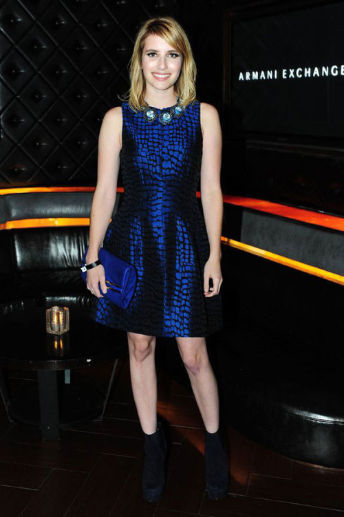 People watching: Emma Roberts dazzles in an electric blue Armani Exchange frock and a matching statement necklace. Learn more about the star's look here »