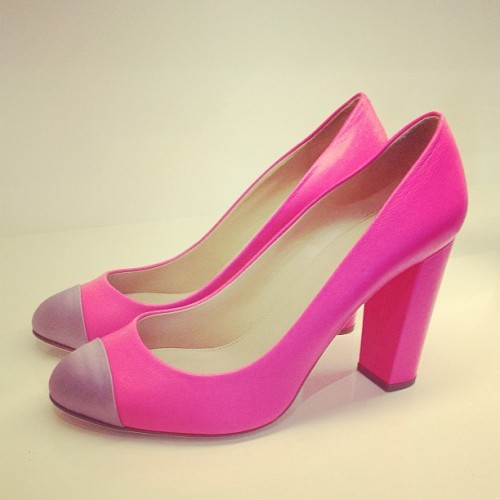 Bright pink satin cap-toe pumps at the J.Crew spring 2013 preview Photographed by Julia Rubin
