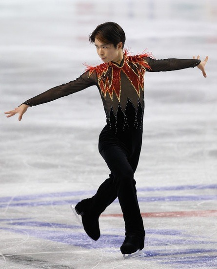 Like Rachael Flatt's Firebird costume, Tatsuki Machida's suffers from too much black sheer. Unlike Flatt, Machida could not fight the allure of the feather.