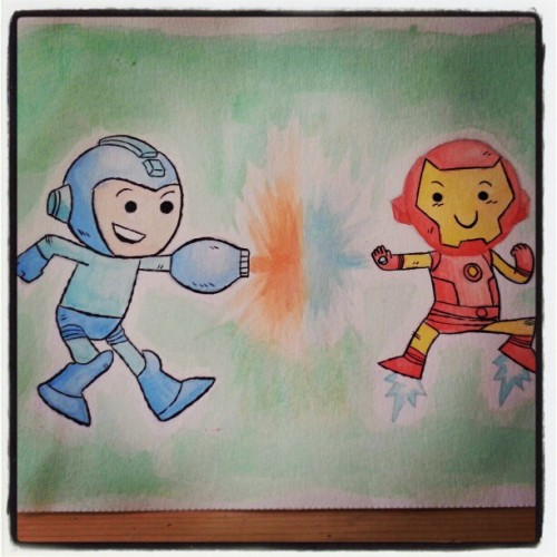 chrishaley:  This is a little watercolor I did of Mega Man & Iron Man!  They're having a fight to see who is the cutest. You can totally buy it if you want in my Etsy shop: http://www.etsy.com/shop/thechrishaleyart  I love this!