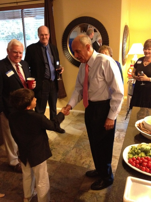 Dr. Carmona shaking hands with a future leader at an event in Tucson!