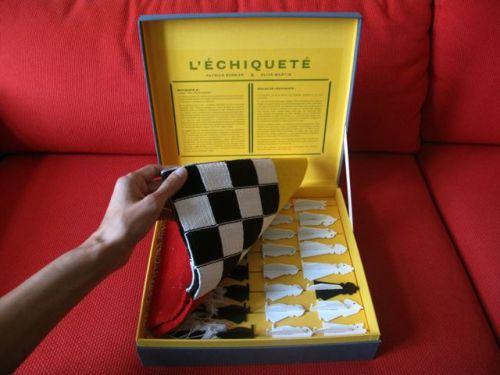 Here are the rules for l'Échiqueté (checkered chess), a project by Patrick Bernier and Olive Martin (past residents of Kadist SF).   The pieces move the same way as they do in classical chess, and their starting positions are unchanged, but, as the game progresses, new characters make an appearance! In a nutshell: the capture of an enemy piece produces a piece belonging to both players, a double agent.   Basics. 1. Each capture produces a new piece in place of the two pieces involved. The player executing the capture decides whether this new piece takes on the nature of the capturing or the captured piece. 2. The new piece arising from a capture is neither white nor black but 'checkered.'  3. All checkered pieces belong to the player currently taking their turn and can capture the opponents pieces (as described in rule 1 above). Their manner of moving remains the same as in classical chess. For the complete set of rules, visit Kadist SF tomorrow night at 6pm.