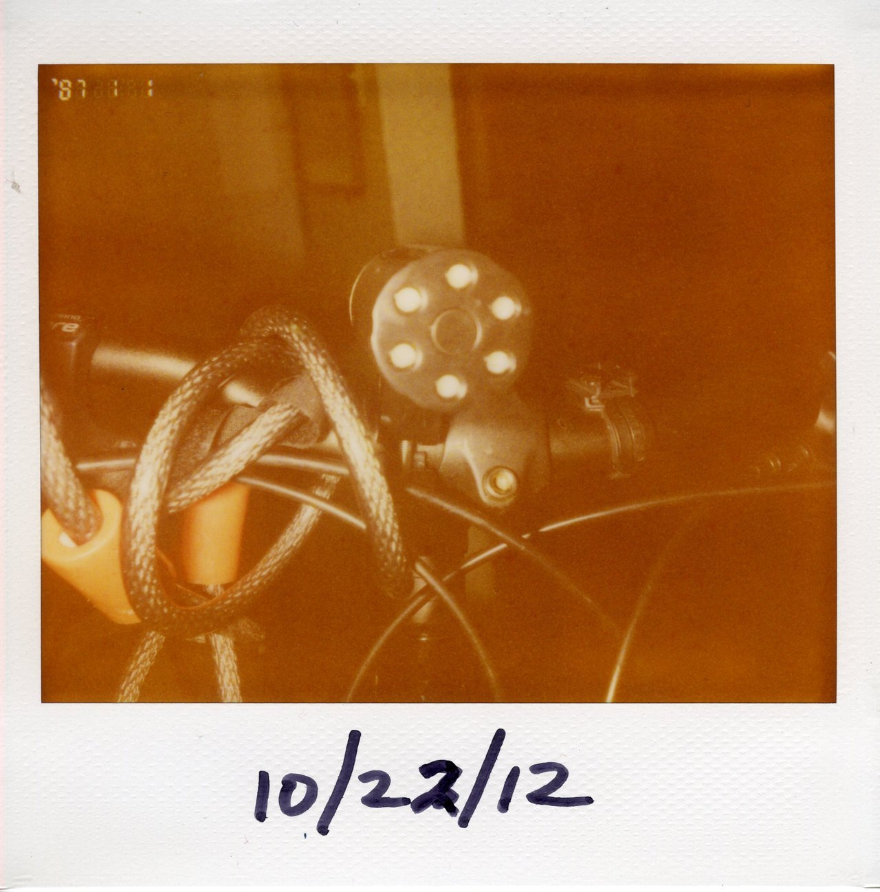 impossibleyear:  Gotham Defender Bike Light Polaroid Spectra ProCam / Expired Polaroid Image Softtone  The first piece of indie hardware I bought on Kickstarter. I'm madly in love with this thing, it's virtually theft proof, brighter and cooler looking than any light I've had before. I lose bike lights like it's my hobby (along with sunglasses, hats and umbrellas) so having this thing mounted to my bike not only keeps me safe, it will save me money in the long run. Check these guys out: http://www.bikegotham.com