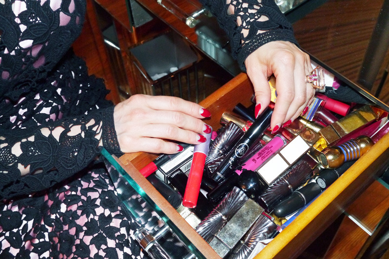 """I also collect vintage lipstick tubes—I freeze my lipsticks and then transfer them to the vintage cases. It's tricky to do, but it's tough to find good, beautiful lipstick cases. I'll do that with whatever red I'm wearing:…I have an entire drawer in my vanity for red lipsticks."" Dita Von Teese photographed by Emily Weiss for Into the Gloss, August 20"