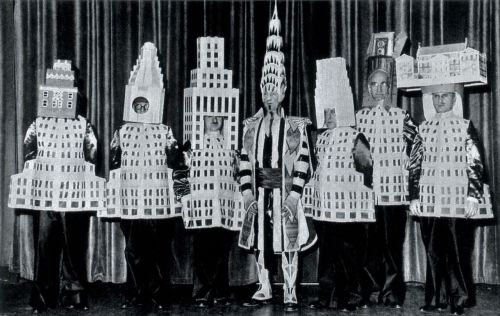 "vintagenational:  Photo from the American Institute of Architects. From left: A. Stewart Walker, the Fuller Building; Leonard Schultze, the Waldorf-Astoria Hotel; Ely Jacques Kahn, the Squibb Building; William Van Alen, the Chrysler Building; Ralph Walker, One Wall Street; D.E. Ward, Metropolitan Life Tower; J.H. Freedlander, Museum of the City of New York City. From ""Skyscrapers: Above the Crowd,"" National Geographic, February, 1989.  Spoofing the profession, prominent architects masquerade as their buildings for the 1931 Beaux-Arts Ball in New York City. As the scene suggests, architects, often forgotten by name, live in the public mind through the fame of their creations.  And don't they look just thrilled to be there?"