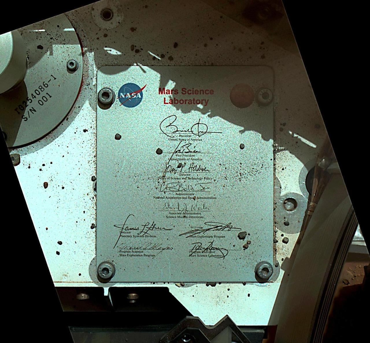 itsfullofstars:  President's Signature Onboard Curiosity  This view of Curiosity's deck shows a plaque bearing several signatures of US officials, including that of President Obama and Vice President Biden. The image was taken by the rover's Mars Hand Lens Imager (MAHLI) during the rover's 44th Martian day, or sol, on Mars (Sept. 19, 2012). The plaque is located on the front left side of the rover's deck. The rectangular plaque is made of anodized aluminum and measures 3.94 inches (100 millimeters) tall by 3.23 inches (82 millimeters) wide. The plaque was affixed to the rover's deck with four bolts. Similar plaques with signatures — including those of the sitting president and vice-president — adorn the lander platforms for NASA's Spirit and Opportunity rovers, which landed on Mars in January of 2004. An image from Spirit's plaque can be found at PIA05034. The main purpose of Curiosity's MAHLI camera is to acquire close-up, high-resolution views of rocks and soil at the rover's Gale Crater field site. The camera is capable of focusing on any target at distances of about 0.8 inch (2.1 centimeters) to infinity, providing versatility for other uses, such as views of the rover itself from different angles.