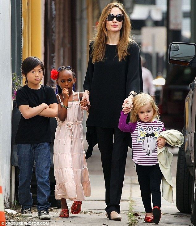 Angelina's brats will star with their mother in her latest movie  Actress Angelina Jolie's children Pax and Zahara join the cast of Maleficent (but Shiloh didn't make the cut). Her daughter Vivienne was cast as the young Princess Aurora. And now two of Angelina Jolie's six children - Pax and Zahara - will also make their big-screen debuts in her upcoming live action film Maleficent. 'They have smaller parts,' a source told Us Weekly, adding the eight-year-old boy and seven-year-old girl will not have speaking roles. 'Shiloh was supposed to be in it, too, but she was bored and not in the mood during the day her part was supposed to happen, so she ended up not being in the film.' The tomboyish six-year-old did, however, have a role as her father Brad Pitt's daughter in his film The Curious Case of Benjamin Button back in 2008. The 37-year-old Oscar winner stars as the title role in Disney's reimagining of the classic fairy tale Sleeping Beauty told from the evil doer's point of view.