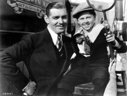 Clark Gable and Mickey Rooney on the set of Manhattan Melodrama, 1934.Mickey played a child version of Clark's character in the film.