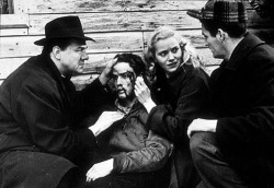 Karl Malden, Marlon Brando and Eva Marie Saint discuss a scene with director Elia Kazan on the set of On the Waterfront, 1954.