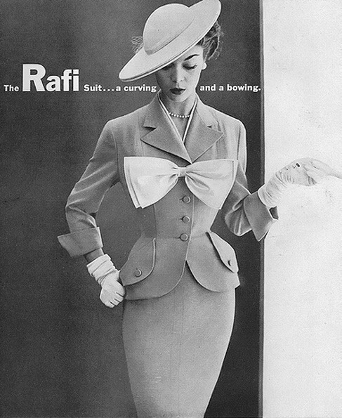 theniftyfifties:  Jean Patchett wearing a Rafi suit in Harper's Bazaar, February 1952  damn…. perfect fit. the bow is terrible, but that outfit is swag