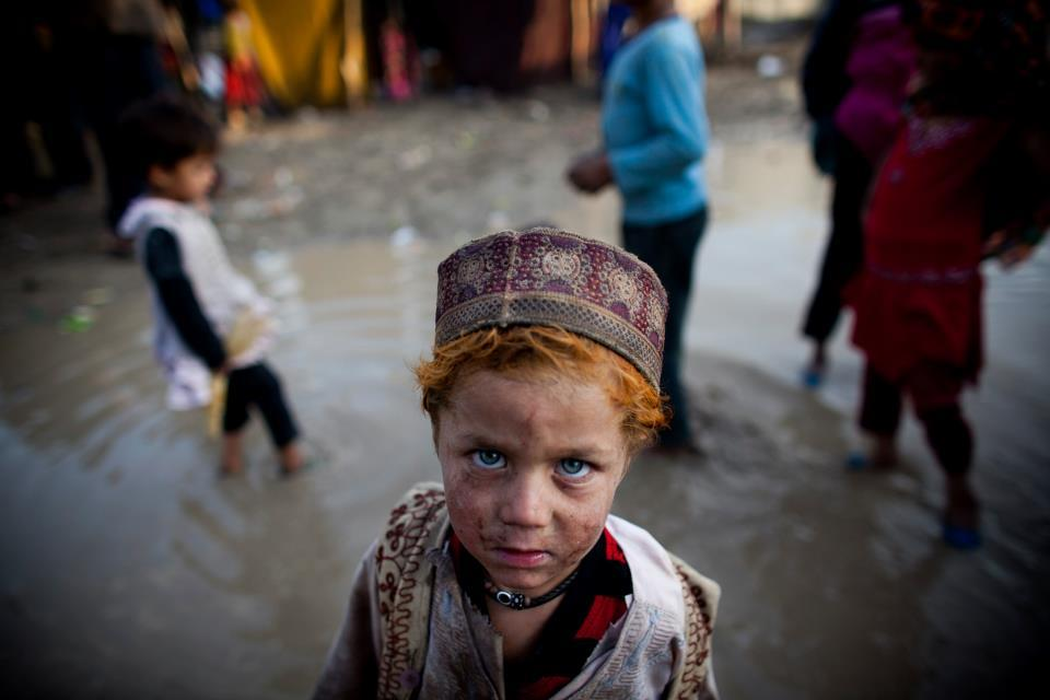 Afghan children live in a refugee camp in Karti Parwan district in Kabul, Afghanistan. (Photo by Majid Saeedi) via Afghanistan in photos