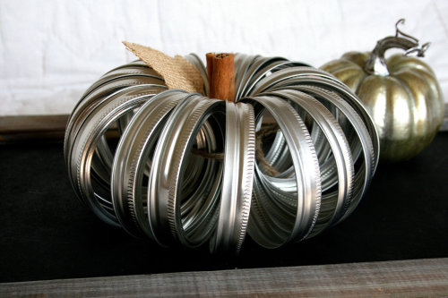 waltzingmatildablog:  Pumpkin made out of mason jar lids! Such a simple, cool idea.