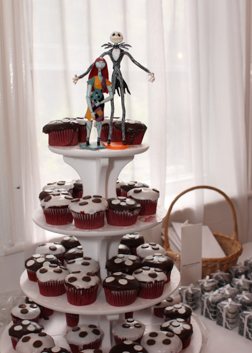 A very cute alternative to a wedding cake, tiered cupcakes with Jack and Sally figures standing guard on the very top. I'm actually considering going this route for our wedding next year.