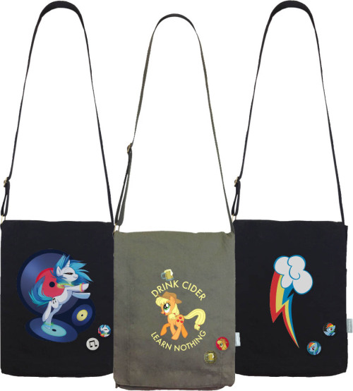"welovefineshirts:  NEW: My Little Pony Vertical Messenger Bags! Dig the latest cool addition to our group of cool AND practical bags, bronies!: Each bag's compartment will fit a 17"" laptop or smaller, and each comes with two FREE buttons! Come see further pictures on the site; more designs coming soon: Browse the latest My Little Pony bags NOW at welovefine.com!"