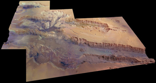 The Solar System's grandest canyon by europeanspaceagency on Flickr.Via Flickr: Valles Marineris, seen at an angle of 45 degrees to the surface in near-true colour and with four times vertical exaggeration. The image covers an area of 630 000 sq km with a ground resolution of 100 m per pixel. The digital terrain model was created from 20 individual HRSC orbits, and the colour data were generated from 12 orbit swaths. The largest portion of the canyon, which spans right across the image, is known as Melas Chasma. Candor Chasma is the connecting trough immediately to the north, with the small trough Ophir Chasma beyond. Hebes Chasma can be seen in the far top left of the image. The image was first published in 2009 in the ESA science monograph Mars Express: The Scientific Investigations. For further information and a higher resolution of this image, please click here.  Credits: ESA/DLR/FU Berlin (G. Neukum)