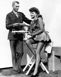 Rita Hayworth receiving fan letter from a soldier on the set of Cover Girl, c. 1944.
