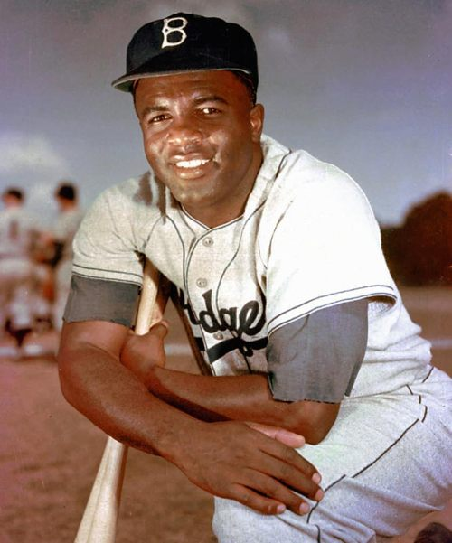 obitoftheday:  Obit of the Day (Historical): Jackie Robinson (1972) October 24, 2012 marks the 40th anniversary of the death of Jackie Robinson, who broke the color barrier in Major League Baseball in 1947. There are myriad sources telling of Mr. Robinson's career and legacy. Obit of the Day will, instead, share some little known facts: Jack Roosevelt Robinson was born on January 31, 1919. He was named for President Theodore Roosevelt who died on January 6 of that year. Jackie attended UCLA and was the first student to letter in four sports: baseball, football, basketball, and track. He won the NCAA Long Jump championship in 1940. While at UCLA his worst sport was baseball. During World War II Robinson enlisted in the Army. In 1944 while serving at Ft. Hood in Waco, Texas he was court martialled for refusing an order to move to the back of a bus because of his race. He was found not guilty. Robinson would play one season in the Negro Leagues for the Kansas City Monarchs. According to Robinson, if Branch Rickey of the Dodgers hadn't recruited him for the majors, he would have quit playing baseball and become a coach at Sam Houston College. Robinson was 28 years old when he stepped on the field on April 15, 1947 as the first African American major leaguer in over 60 years. He won the Rookie of the Year award, which is now named for him. Here are his stats for his career with the Brooklyn Dodgers which included the 1949 MVP Award as well Brooklyn's only World Series victory in 1955. Jackie played himself in The Jackie Robinson Story (1950), his wife was played by Ruby Dee. He was traded to the New York Giants, the Dodgers NL rival, after the 1957 season. He never played for the Giants having already signed a contract to work for Chock Full O' Nuts - a coffee company. In 1965 Robinson became the first African Americans sports analyst when he worked on ABC's Game of the Week. Robinson was a Republican, supporting Richard Nixon in the 1960 election as well as Nelson Rockefeller's presidential and gubernatorial bids. He left the party in 1968 after they failed to support civil rights legislation in the 1960s. Robinson's last public appearance was at game 2 of the 1972 World Series (October 15) where he threw out the first pitch in honor of the 25th anniversary of the integration of baseball. The Cincinnati Reds were playing the Oakland A's. He died at the age of 53 from a heart attack in his home. His eulogy was given by the Reverend Jesse Jackson. In 1997 Jackie Robinson became the first, and so far only, player to have his uniform number retired throughout all of baseball. (Wayne Gretzky is the only other professional athlete to earn that honor.) Family notes: Jackie's brother, Mack Robinson, won the silver medal at the 1936 Berlin Olympics in the 100 meter sprint. Jesse Owens finished first. Jackie's wife, Rachel, was an associate professor of psychiatric nursing at Yale University at the time of Jackie's death. Jackie's son, Jackie Jr., died in a car accident in 1971. He was only 27. Sources: NYTimes, jackierobinson.com, Wikipedia, IMDB, The National Archives, baseball-reference.com (Image is copyright of the Associated Press and courtesy of nabnyc.blogspot.com ) And here's the trailer for the April 2013 release of the film 42. Yes that's Harrison Ford as Branch Rickey and Chadwick Boseman as Jackie. Music by Jay-Z.