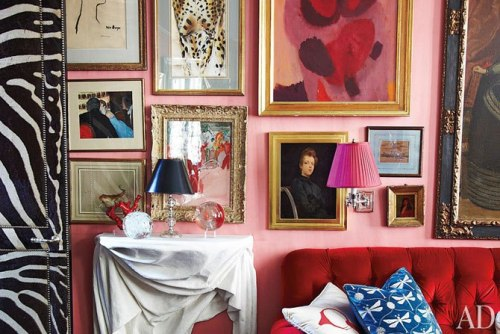 An eclectic art collection on the walls of interior designer Miles Redd N.Y.C. living room, featured in his new hardcover The Big Book of Chic (Assouline). Image via Architectural Digest
