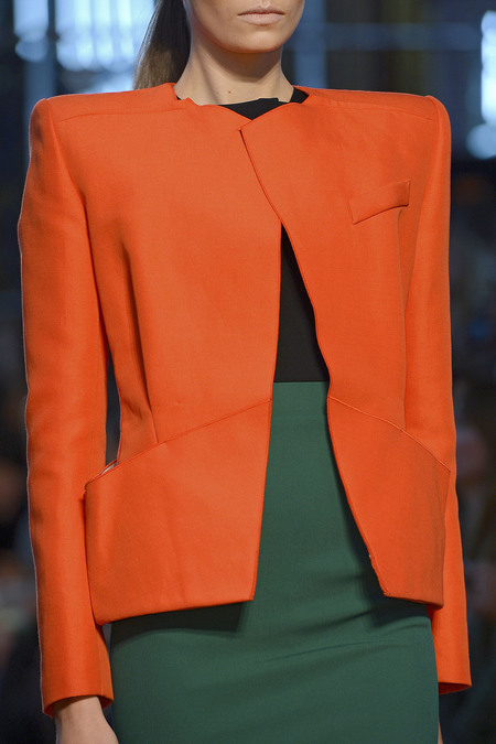 A sophisticated and structured blazer in bold red at the Roland Mouret Spring 2013 show. Image via Style.com