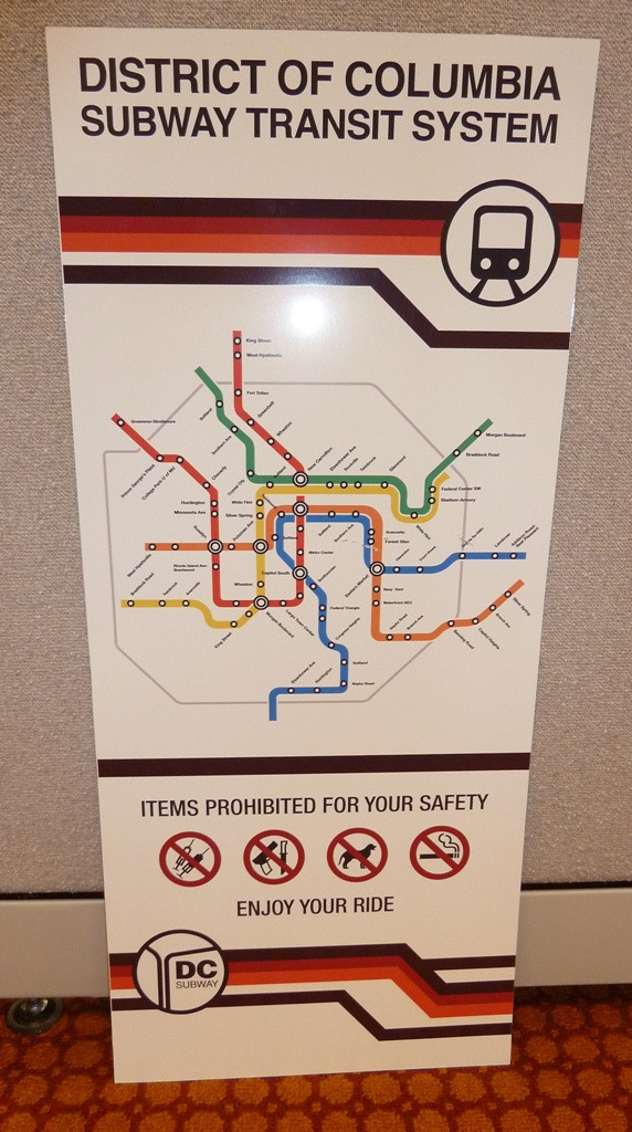 "Fantasy Map: DC Subway Map from ""Leverage"" Just good enough to pass for the real thing when fleetingly seen in the background of a TV show. The map uses real DC Metro station names, but they're all in the wrong places. The ""corporate identity"" uses the colours from the old TriMet livery… which is kind of neat, seeing as the show is filmed in Portland, TriMet's base of operations. In the show, I believe that the Washington Park MAX station (the only underground station in the system) stands in for DC Metro stations. (Source: TriMet/Flickr)"