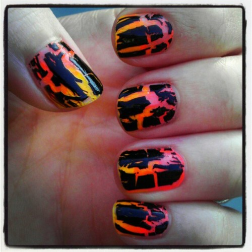 Black crackle on top of a gradient of 2 neon oranges. How Halloweenie of me. #neon #notd #crackle #nailpolish #halloween #orange
