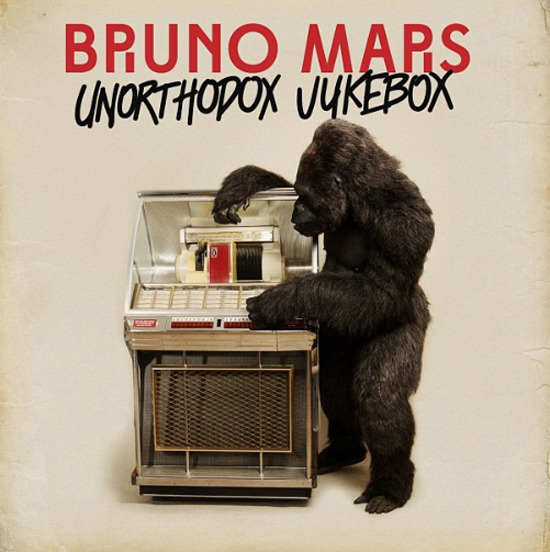 "Album Cover: Bruno Mars - ""Unorthodox Jukebox"" + Tracklist Bruno Mars has a serious obsession with gorillas… kind of remind of rapper Kanye West's ""Dropout Bear"" mascot. Anyway, Bruno Mars unveiled the album cover for his upcoming sophomore release, Unorthodox Jukebox  (out on December 11th) today!  The cover features an inquisitive gorilla playing a jukebox.  Bruno seemingly is going for a more vintage type stylization that we clearly saw in his new music video for 'Locked Out of Heaven' and now with his album cover. No problem here, I like this direction. So far Bruno's lead single 'Locked Out of Heaven' currently sits at the number 15 on Billboard's Hot 100 chart and he recently debuted a ballad entitled 'Young Girls' during his stint on SNL last weekend. Bruno's visit to Saturday Night Live grossed the highest views this season. The crooner is also lined up to perform at The 2012 Victoria's Secret Show alongside Rihanna and Justin Bieber if you didn't know. The VS fashion show is set to air on December 4th at 8 pm 