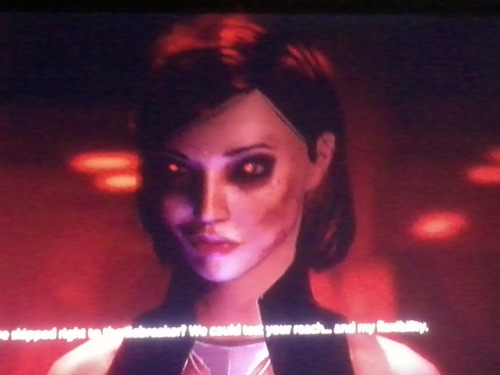FemShep testing her flexability and Garrus's Reach. ME2 Custom Renegade Shep —submitted by Robert (javik448@gmail.com)