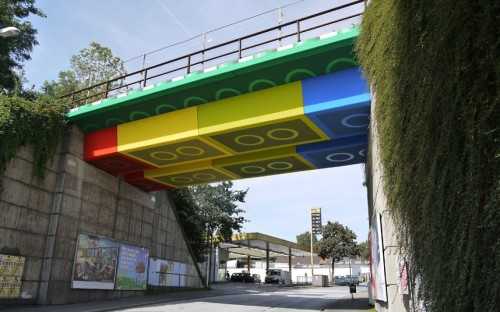 A disused railway bridge appears to have been built using gigantic versions of Lego bricks. It is the work of street artist Megx - real name Martin Heuwold - who decided to transform the grey structure in Wuppertal, Germany.       Picture: Rolf Dellenbusch / Rex Features