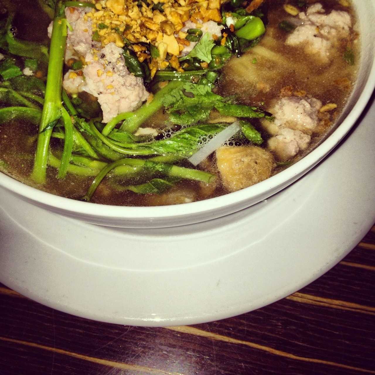 Porky soup - pork meatballs, crispy pork slices, some greens, rice noodles and peanuts in a somewhat lightly flavored broth. It was ok, not awesome. At Thai House,