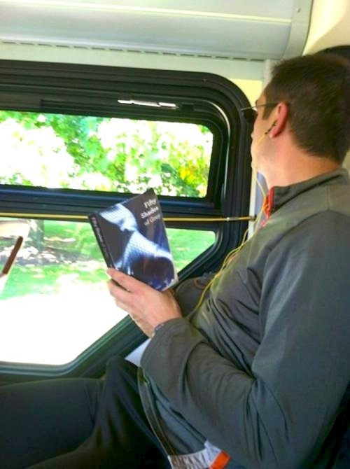 Man Far Too Excited Reading 50 Shades of Grey on Bus Obviously he just has a thing for great narrative.