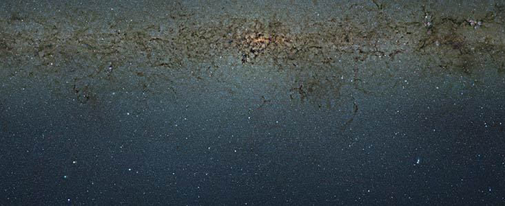 Staring Into Galactic Infinity The European Space Organization (ESO) has just released the stunning photo above. At first glance, its just another fine piece of star porn, beautiful little glowing dots and clouds, like so many others whose images we have captured in our quest to catalogue the observable universe. But this one is special.  This is a nine-gigapixel image was taken using a telescope that looks into the infrared, allowing us to see through the dusty galactic arms. The view is of the galactic center of the Milky Way, our home. That means somewhere in the glowing center lies a black hole, and we are here, rotating around it. The photo marks the largest catalogue of Milky Way stars ever assembled. If you made counting all of the 84 million objects so far identified in this picture a full-time job, counting 16 hours per day at a comfortable pace, it would take you somewhere in the neighborhood of 20 years to finish. If it were printed at book resolution, that image would be 9 meters tall and 7 meters wide. And this is less than 1% of the whole sky. In just our own galaxy.  We live in a big neighborhood. Here's an extra-large image. Here's a semi-overwhelming zoomable version sure to keep you occupied for the next several forevers.