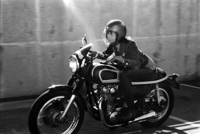 A motolady riding a 1975 Yamaha XS650 cafe tail style custom. Could not for the life of me find the source of this. Awesome shot though. Tamara Raye- photo from Dice Magazine, shot by Michael Schmidt.
