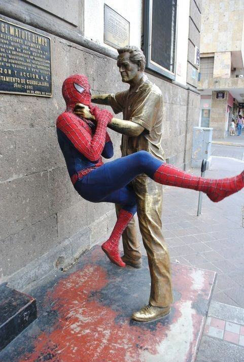 The statue duo depicts a man choking the naughty spider man.Via 9gag