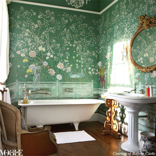 Pretty to the max, a clawfoot bath tub is the perfect foil to exquisite green de Gournay handpainted wallpaper in this bathroom. Photograph courtesy of Balfour Castle.