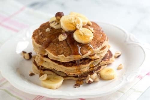 prettybalanced:  Spiced Buttermilk Banana Pancakes  Spiced Buttermilk Banana PancakesServes: 4Ingredients    1 cup all-purpose flour    1 tablespoon sugar    1 teaspoon baking powder    1/2 teaspoon ground cinnamon    1/8 teaspoon ground nutmeg    1/4 teaspoon salt    1 cup buttermilk    1 egg    3 tablespoons butter, melted    1 banana, mashedFOR Serving    Warm maple syrup    2 bananas, sliced    chopped nuts (we used hazelnuts) Source