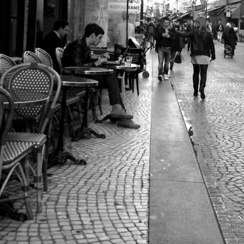 newsweek-paris-france:  A cigarette and a laptop on Rue Montorgueil this afternoon. The computer notwithstanding, it still feels like the '60s.