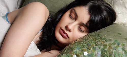 "scinerds:  Scented Sleep Can Wash Your Fears Away  Sleeping helps us reset our brains and calm our emotions. Perhaps it can do more, though: if sleepers are exposed to odours they associate with bad memories, it appears they can lose the fear those memories bring.  Previous studies have shown that sleep helps eliminate fear in general. But whether it is possible to focus this effect through the careful use of odours has not been tested in humans.  Katherina Hauner and Jay Gottfried of Northwestern University in Evanston, Illinois, exposed subjects to four pictures of faces and a series of inoffensive smells such as mint. When one of the faces appeared, the volunteers got a painful electric shock.  Afterwards, the researchers measured the amount of electricity conducted by the subjects' skin – a measure that goes up when afraid, because the sweat produced is a good conductor. The researchers found that conductance spiked whenever the volunteers saw the face associated with the shock.  They then let half the subjects sleep, and exposed this group to variable amounts of the odour that had been presented along with the ""painful"" face. The next day, these volunteers were much less afraid of the face – and those with the least fear were those that had received the highest exposure to the odour while asleep. Brain scans also showed that brain areas associated with fear and with memory were less active after this exposure.  The other group of subjects stayed awake while they received pulses of the odour associated with the ""painful"" face. Unlike the sleeping group, however, these volunteers became more afraid of the face with greater exposure to the odour.  The question now is why sleep dissociates the fear from the image, rather than reinforcing the connection. Hauner says a clue may lie in reports from the awake volunteers, who said they saw the face in their minds every time they smelled the odour.  The technique could eventually enhance treatments for posttraumatic stress disorder by associating images from the traumatic memory with a smell, and then using odour exposure while sleeping, says Hauner. The next step is to study whether the effect occurs during REM sleep or slow-wave sleep.  Hauner's team presented their study at the Society for Neuroscience. conference in New Orleans, Louisiana, last week."
