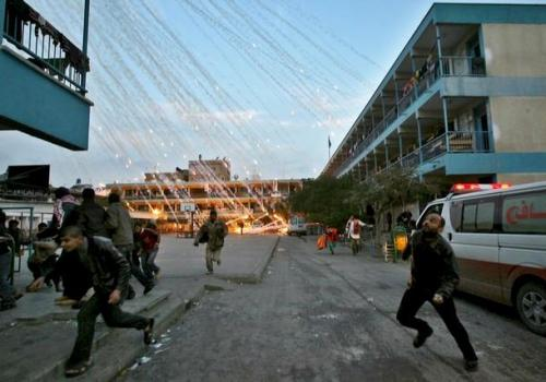 hragv:  This is a pretty unbelievable photo from January 19, 2009, of Israeli forces bombing a school run by the United Nations agency for Palestine refugees (UNRWA) in Beit Lahiya in the northern Gaza Strip